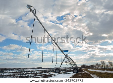 Irrigation of farmland, in winter conditions - stock photo