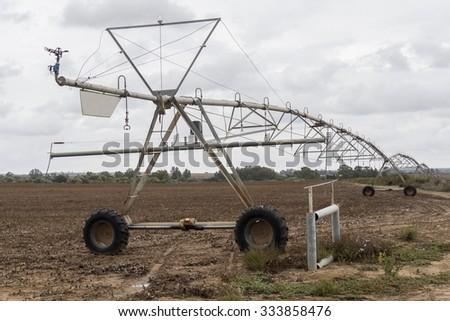 Irrigation pivot system watering - stock photo