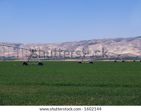 irrigation system on wheels in Israel - stock photo