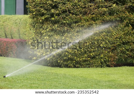 Irrigation System Watering the Garden - stock photo