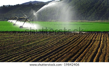 irrigation system working on a farm - stock photo