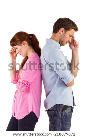 Irritated couple ignoring each other on white background - stock photo