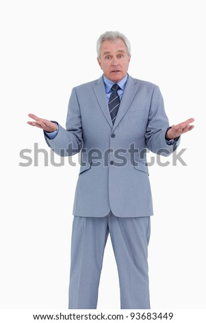 Irritated mature tradesman against a white background - stock photo
