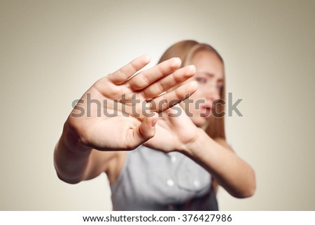 Irritated woman showing her hand against please stop. Negative emotion facial expression feelings, signs symbols, body language