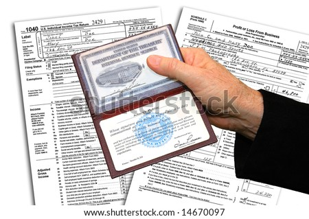 IRS agent presenting his credentials before initiating a federal income tax examination.