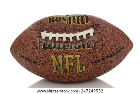 IRVINE, CA - JANUARY 23, 2015: A Wilson NFL Official Football on white with reflection. An under inflated football like the one used in the current controversy called  deflate-gate. - stock photo