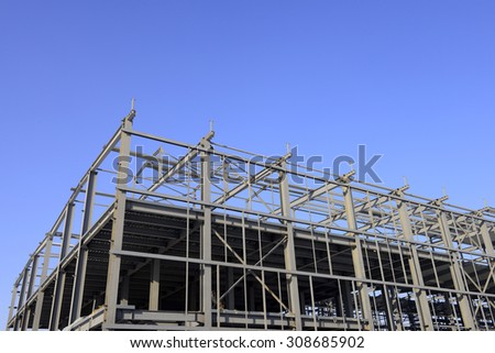 Is the construction of the steel structure factory building under the blue sky