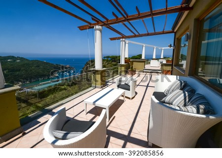ISCHIA, ITALY - June 23, 2013: Beautiful view from a luxury hotel San Montano on the sea and island - stock photo