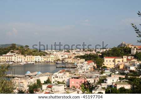 Ischia Porto, Italy, showing harbor district. Castle Aragonese is in the distance.