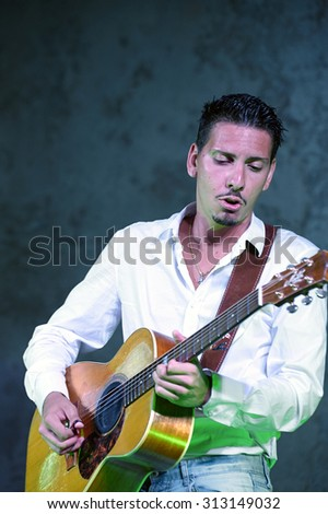 "ISEO, ITALY - AUGUST 28: Italian guitar player Andrea Valeri at the event ""Acoustic Franciacorta 2015"" on August 28, 2015 in Iseo, Italy"