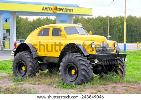 ISETSKOE, RUSSIA - AUGUST 29, 2013: Monument of the big foot style modified vintage soviet vehicle GAZ M20 Pobeda near the gas station. - stock photo