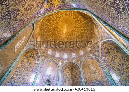 Isfahan, Iran - December 13, 2015: Sheikh Lotfollah Mosque at Naqhsh-e Jahan Square in Isfahan, Iran. Interior view  - stock photo