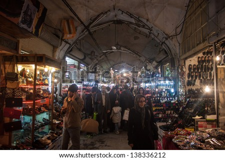 ISFAHAN, IRAN - MARCH 7: People in bazaar on March 7, 2013 in Isfahan, Iran. Grand Bazaar was originally constructed during the 11th century.