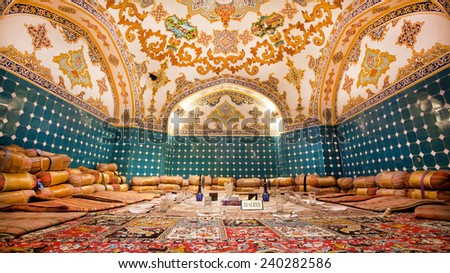 ISFAHAN, IRAN - OCT 15: Beautiful restaurant room in oriental design style with carpets and artistic atmosphere on October 15, 2014. Third largest city in Iran, Isfahan is example of Islamic culture