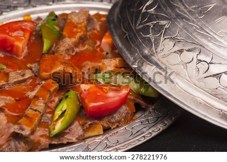Iskender kebab with tomatoe and paprika - stock photo