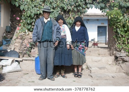 ISLA DEL SOL, BOLIVIA - NOVEMBER 2008 : A family walks home after a hard day's work . Isla del Sol, Bolivia .