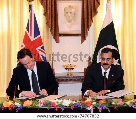 ISLAMABAD, PAKISTAN - APR 05: Syed Yousuf Raza Gilani, and UK Prime Minister, David Cameron sign declaration on Enhanced Strategic Dialogue during signing ceremony on April 05, 2011in Islamabad. - stock photo