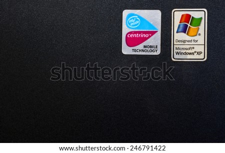 ISLAMABAD, PAKISTAN, APRIL 09, 2014: Sticker with logo of Microsoft windows XP on a laptop computer. - stock photo