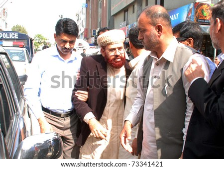 ISLAMABAD, PAKISTAN - MAR 16: Former Federal Minister for Religious Affairs, Hamid Saeed Kazmi moves towards court for his case-hearing on March 16, 2011in Islamabad.