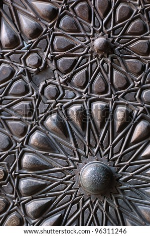 islamic carving on a door - stock photo
