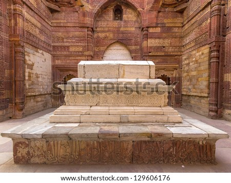 islamic grave with inscriptions at qutub minar in Delhi, India - stock photo