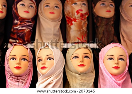 Islamic head scarfs on display in a middle eastern market - focus on front row - stock photo