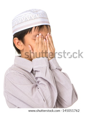 Islamic pray explanation. Asian child showing complete Muslim movements while praying - stock photo
