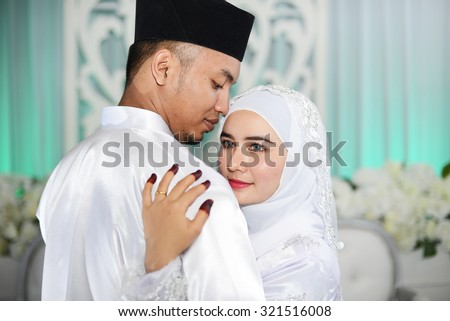 Islamic wedding ceremony malay wedding couple stock photo islamic wedding ceremony malay wedding couple junglespirit Image collections