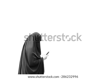 Islamic woman dressed in a full burka using a smartphone isolated on a white background