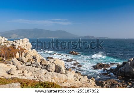 Island Coastline, Santa Cruz Island, Channel Islands National Park, California. stones on the background of the ocean  - stock photo
