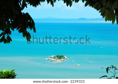 Island in blue sea and sky - stock photo