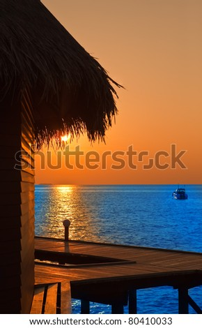 Island in ocean, Maldives.  Sunset - stock photo