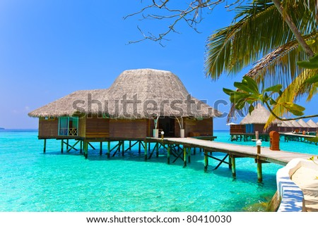 Island in ocean, overwater villa. Maldives. - stock photo