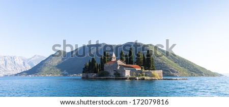 Island of Saint George is one of the two islets off the coast of Perast in Bay of Kotor, Montenegro - stock photo