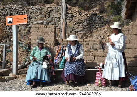 ISLAND OF THE MOON, BOLIVIA - SEPTEMBER 4, 2010 : Island of the Moon is located on lake Titicaca. At the time of the Incas lived here in seclusion young women. Unknown womans on the island of the Moon