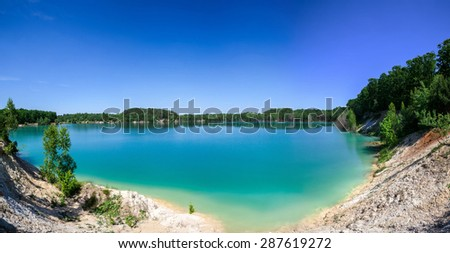 island on a background of blurred sea with mountain views  - stock photo