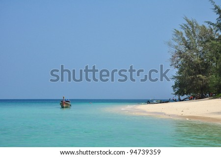 Island Paradise  over a sandy white beach with stunning blue waters - stock photo