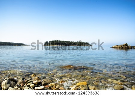 Island scene and shoreline at Schoodic Peninsula in Acadia National Park, Maine.