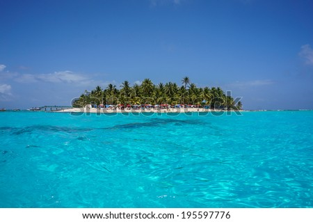 Island surrounded by crystal blue water in San Andres, Colombia - stock photo
