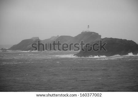 island with lighthouse - stock photo