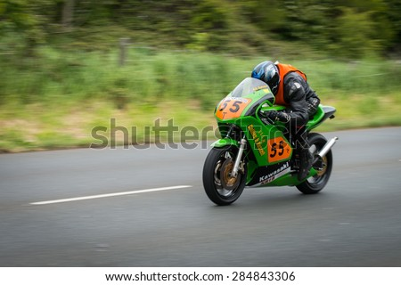 ISLE OF MAN, UK - MAY 30: A rider in the Southern 100 motorcycle singles race, the Pre TT Classic Road Race undergoing practice on 30 May 2015 in the Isle of Man (Public Event)