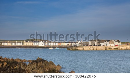 Isle of Whithorn Harbour.  The view across Isle of Whithorn Bay to the small coastal village of Isle of Whithorn in Dumfries and Galloway, Southern Scotland. - stock photo