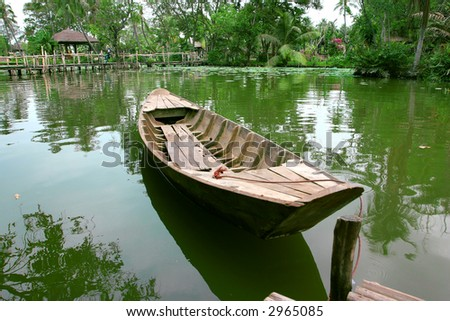 isolate boat floating on the quite lake