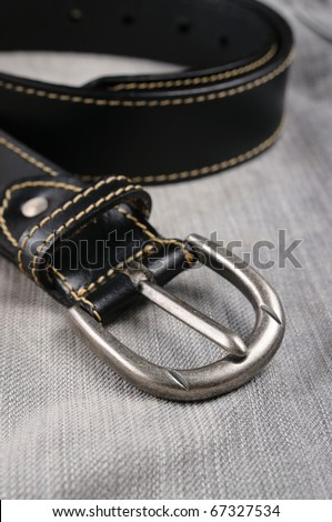 isolate classic black leather belt jeans - stock photo