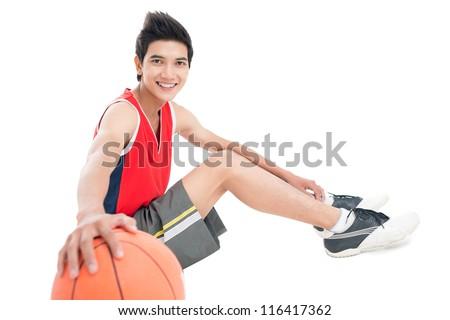 Isolate portrait of an athlete sitting on floor - stock photo