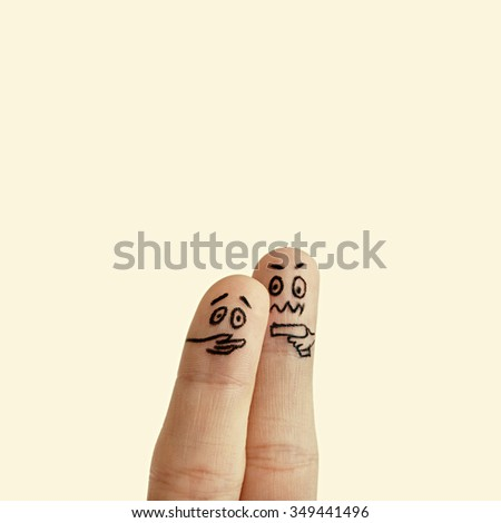 Isolated and toned image drawn on fingers hostage and gangster with a gun - stock photo