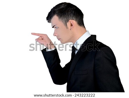 Isolated angry business man pointing