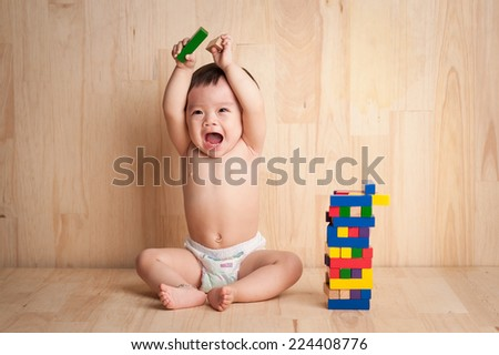 Isolated asian kid girl playing with toys , white background - stock photo