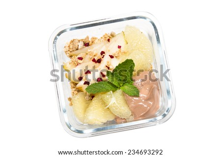 Isolated background kids lunch box: Sweetie, pear, chocolate ricotta, mint and granola with cherry chips - stock photo