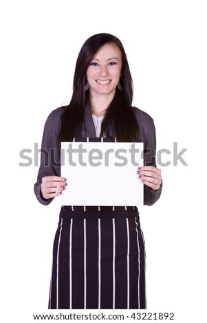 Isolated - Beautiful Girl in the Kitchen Holding a Blank Sign - stock photo